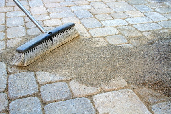 Awesome Grout For Pavers #1: Putting-Down-Patio-Pavers-finishing-edited--14056.jpg