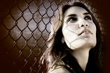 girl against chainlink fence
