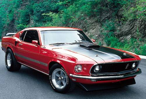 My first love was a younger lady....look at those hips and what a shake..shaker hood that is.  candy apple red, black dayglo stripes, flat black hood stripes, 351-4bb with stick shift...i still miss her 21 years later
