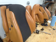 Car leather seats done over burnt orange using airbrush