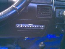 eq in cubby hole under steering wheel