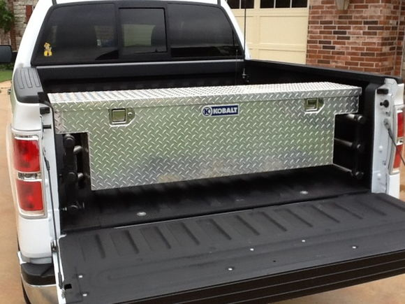 Small truck tool box mounted to the bed extender...