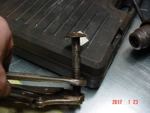 """Bed bolt removal trick. I have a primed 4"""" X 4""""X 1/4"""" plate to put on the bolt to cover the ripped hole."""