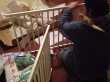 My husband finally setting up the crib