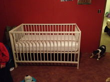 And the crib set up. I'm going to have to rent a rug doctor and clean the floors. The room is in shambles from a switch we made but never really finished. So we're still trying to get everything together while dealing with the mess from the move. Oh and an Itty Bitty Kitty (her actual name)