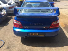 Rear spoiler and boot £350 Rear lights £100