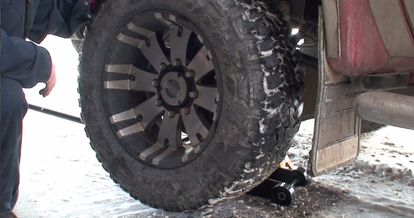 To remove a wheel break the bolts while the truck is still on the ground finish removing them when it is suspended