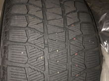 Tire bars still visible and not flush with the depth.