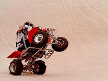 Another wheelie pic(this is also going around a dune just dosn't look like it)