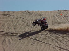 Here I am doing wheelies on Buttercup Hill at Little Sahara