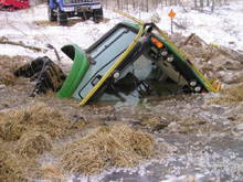 The ground was snow covered, but underneath this trail groomer found an unfrozen swamp in early December 09. During three days of futile attempts to pull it out, this large machine kept sinking deeper, untill it tipped over. It was finally retrieved with the help of special equipment. ATV RIDERS, BEWARE OF THE BOTTOMLESS SWAMPS OF NORTHERN WISCONSIN.