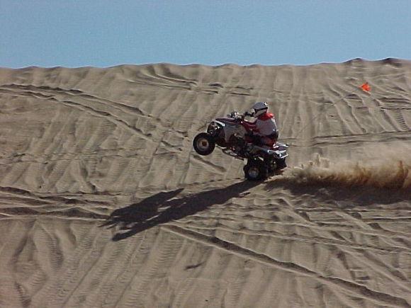 Here I am doing wheelies on Buttercup Hill at Little Sahara