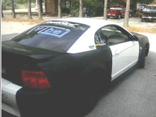 The back of the car but the doors are black now