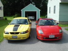 My current 2 cars.  03 Mach 1 and 02 Eclipse GT.  The Z-28 in the garage was sold soon after this picture was taken.