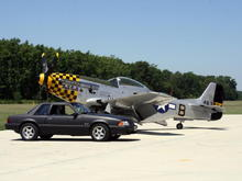 This is a pic of the car in front the P-51 mustang