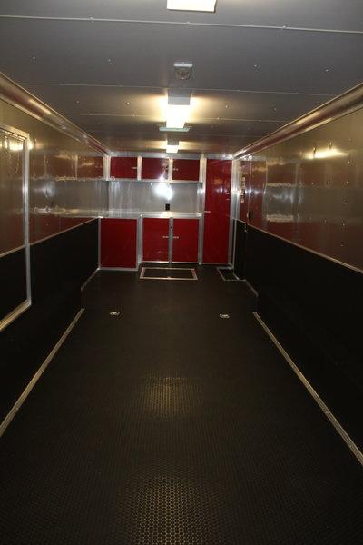 2020 32' Millennium Tri-Axle, Wing, Red Cabs w/Closet