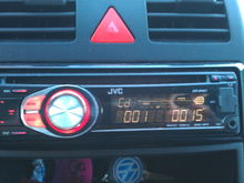 How do I can in the audio settings menu on this JCV car stereo?