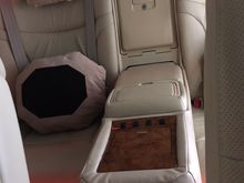 Back seat center console - switches control power lock, sunshade, front passenger seat, interior lights .