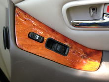 The electric switch plate with wood grain finish.