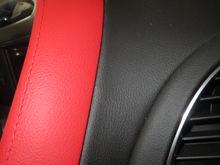 3LT Upper Dash Pad (Red Leather?) 2LT Black Dash (Vinyl)  Similar Textures.  Perhaps Cow Dependent!