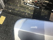 Scrape on top passenger side edge that can be felt with a finger nail