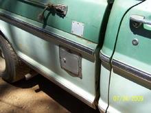 Passager side fuel door