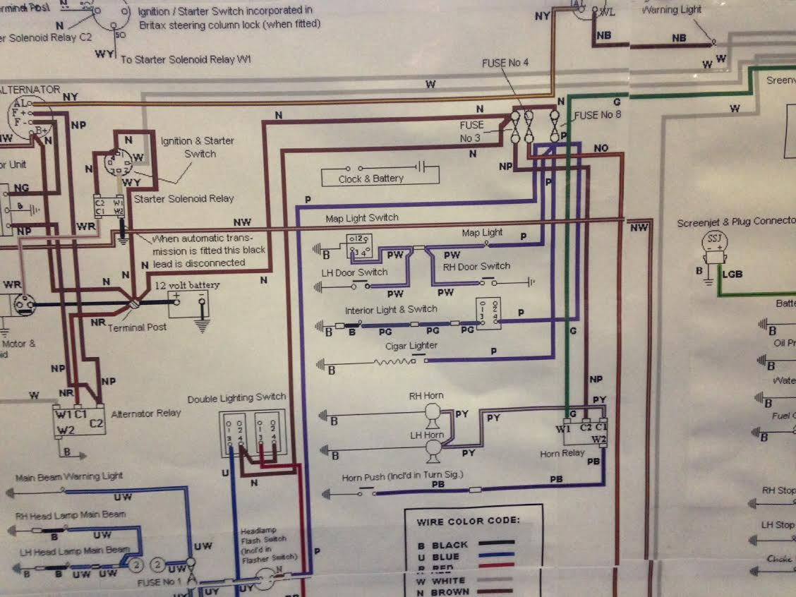 Some time ago I'd found a 1970 wiring diagram on the net, printed it up and  tacked it to the wall. Here is a close up of the door wiring.