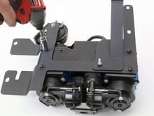 Remove the bracket and bolt up to the bottom of the ARB Twin compressor.