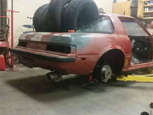 ignore the tires... had to put weight in the rear so when I use a pole jack on the axle it would weigh the car down and not lift allowing me to get the axle up as high as I could and build the system to clear it...