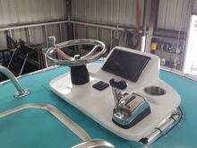 Suzuki fly by wire, trim tab, power poles, jackplate controls on wheel. Stereo is control thru the garmin 942xs
