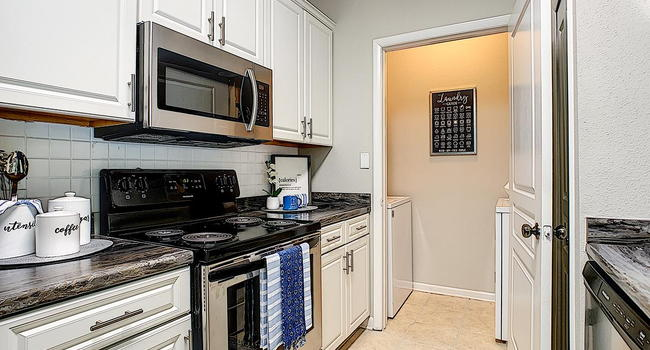 Your newly renovated kitchens feature stainless steel appliances and your very own laundry room.