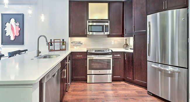 Kitchens with Quartz countertops and stainless steel appliances