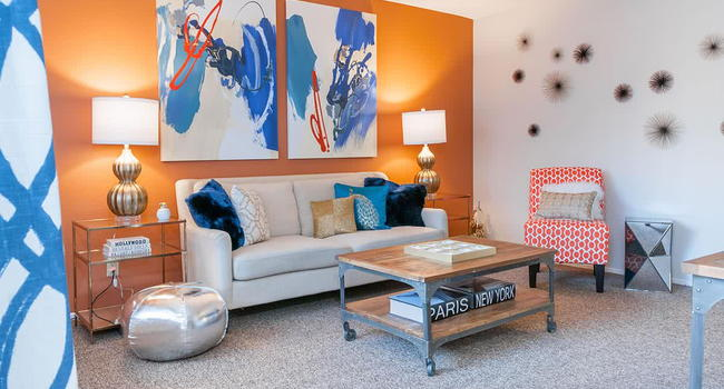Spacious living rooms with plush, neutral carpeting.