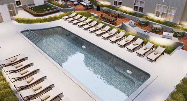Resort-inspired pool with sundeck